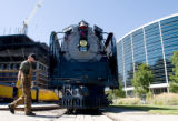 Scott Turley (cq), a train engineer, passes by the Union Pacific Railroad's last steam locomotive,...
