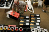 Jeremy Sanders organizes boots at Colorado Ski and Snowboard on Monday, August 18, 2008. The store...