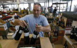David Bernard, who works for a local distributor of classic wines, moves stock on a busy Sunday at...