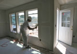 Matalio Torres (cq) works on windows in a Habitat for Humanity home, Monday morning, August 18,...