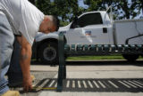 DM1772  Anthony Madrid with Denver Parks and Recreation takes some measurements as he installs a...