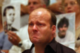 (Denver, Colo., June 13, 2004) David Brien (cq), of New Orleans, LA, cries while volunteers hold...