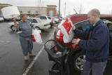 DM0910  Martha Tate, left, and Bobby Pattillo load up their purchases after doing some after...