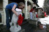 Maggie Miller, 15 gets help holiday decorating with friend Troi Davis, (cq)14, (l-r) in Park Hill...