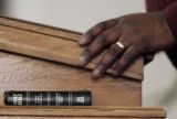 (0109) Ted Davis, places his hand next to the bible as he sings at Providence Bible Church in...