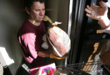 Employee, Richard Roth loads a turkey into her basket for a client in the pantry at Jewish Family...