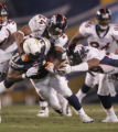 (0006) Champ Bailey and Vernon Fox try to tackle LaDainian Tomlinson in the second quarter of the...