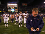 (0994) Mike Shanahan walks off the field at the end  of the fourth quarter of the Denver Broncos...