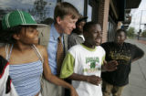 Denver Mayor John Hickenlooper visits with students, (L-R) Latrice Vassel , 14 (cq) Anthony Black...