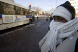 DM2469   Erin Mooty bundles up as she waits for her bus in Denver Monday, Dec. 15, 2008. (DARIN...