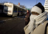 DM2479   Erin Mooty bundles up as she waits for her bus in Denver Monday, Dec. 15, 2008. (DARIN...