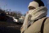 DM2486   Erin Mooty bundles up as she waits for her bus in Denver Monday, Dec. 15, 2008. (DARIN...