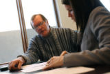 MJM234  Jim McGinnis of Gerretson Real Estate looks over papers with auctioneer, Janelle Karas,...