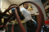 39 year-old Jaime Rodriguez (cq) prepares his gas torch, as he tries to fix a frozen pipe at a...