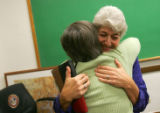 (0286) Lois Court, representative-elect of District 6, right, hugs Lofgren family friend Cindi...