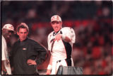 SB-WRAP#1- Denver Broncos Terrell Davis, left, Head Coach, Mike Shanahan, center, and John Elway,...