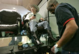 0123 Sen. Ken Salazar has his boots shined at Executive Shine while he waits for a plane to...