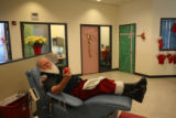 74 year-old Edgar Meyers (cq) from Lakewood, waits for an employee at Bonfils Blood Center to draw...