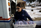Danelle Martinez (cq), a United States postal worker for nine years organizes her mail truck near...