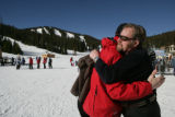 Henry Bremers (cq) who was worked at Eldora Ski Resort for 23 years hugs Rob Linde (cq) (red) who...