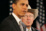 0117 U.S. Sen. Ken Salazar, looks up at the balcolney while President-elect Barack Obama...