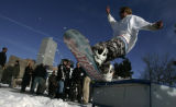 Snowboarder Mike Lucido (cq) from Winter Park  rides a tabletop built at Civic center Park ...