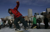 Snowboarder Brett Summers  (cq)   rides a tabletop built at Civic Center Park  Wednesday  December...