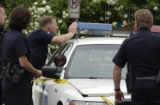 (WHEATRIDGE, Colo,; May 30, 2005) Denver Police gather around one of there patrol cars that was...