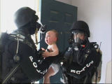 Undated photo of a child being removed from a home by police.