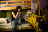 Shelley Forney (cq) sits on her daughter Erica, 9, (cq) bed at their house in Fort Collins,...