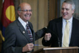 Governor Ritter jokes with Bernie Buescher, left, during a press conference in the Governor's...