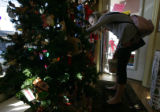 Brigid Flanagan, 13 of Denver looks for a tree ornament for their pet that died at The Whole Cat...