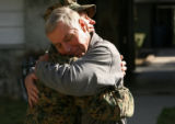 MJM152  Pausing in front of the media, Lance Cpl. Lance Hering hugs his father, Lloyd Hering...