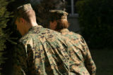MJM163  Lance Cpl. Lance Hering is escorted away after he said goodbye to his parents, Elynne and...