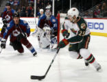 CODZ106 - Minnesota Wild center Eric Belanger, right, looks to pass as Colorado Avalanche...