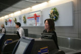 Bettan Bjorklund (cq) an employee of Continental Airlines checks passengers in for outgoing...