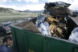 Adrian Bloomfield (cq) owner of Valley Recycling in Granby, CO stands next to a scrap trailor in...