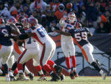 (0586) D'J' Williams tackles Trent Edward in the first quarter of the Denver Broncos against the...