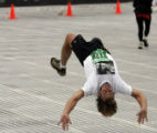 Steve Labington, 43, of Boulder, does a front handspring flip as he makes the last turn in Folsom...