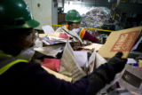 Rosa Maria Lopez (cq) (back) and Veronica Reyes (cq) (left) sort through recycling material at...