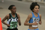 Merima Hashim, left, of Ethiopia, looks at Elva Dryer, right, of the USA, as Dryer pulls away in...