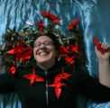 Katie Schmidt, 24 has high hopes on her paper cranes on Monday December 22, 2008 in Denver, Colo....
