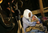 DM4891  Little Joel Vereen is held by his mother, Ashley Vereen, as they portray baby Jesus and...