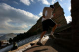 MJM018  Vince Vranesic (cq) of Denver, Colo. runs the stairs at Red Rocks Amphitheatre in...