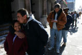 (0076) Daniel Martinez gives ahug to his daughter Desiree Martinez as they wait in line for a meal...