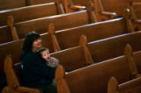 (0212) Walker Hughes, yawns as he is held by his nanny Jeannie Hughes at the Advent Organ Recital...