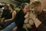 DM1008  LEG56403 Susan Harvey and her daughter Cori Harvey, 18, cuddle with their dog Sadie after...