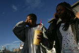 Marquise Spencer, 14, (cq) rubs his head after getting a brain freeze from drinking a slurpee next...