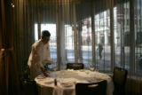 Chef Matt Mine sets a table for his an Italian seven seafood dinner at the Oceanaire Seafood Room...