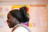 Sudanese student Mary Nakiru, 22, laughs during class at the Thinking Outside the Box Homeschool...